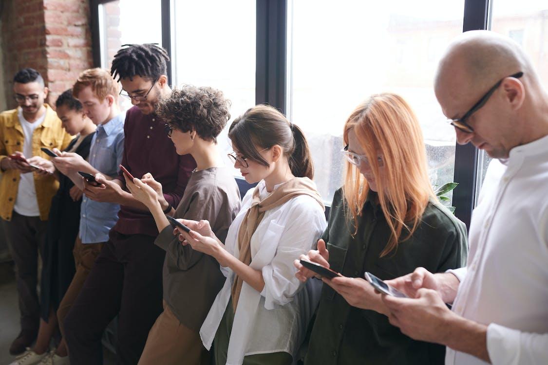 Photo Of People Using Smartphones