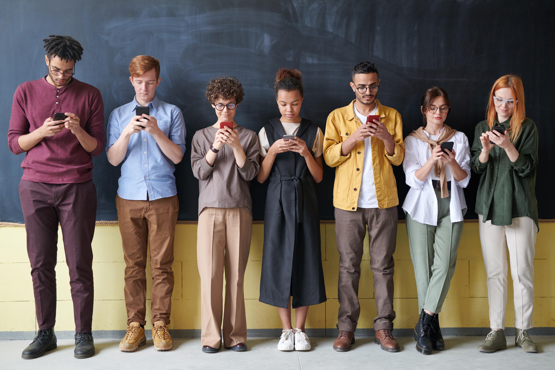 Photo Of People Standing Near Blackboard