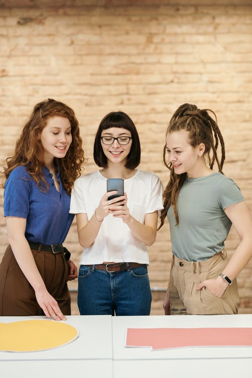Photo Of Women Looking On Smartphone