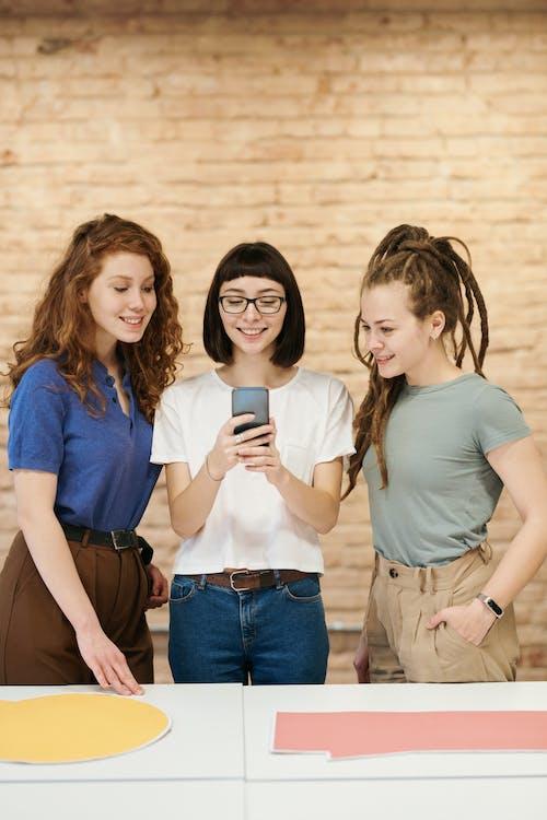 Photo Of Women Looking On Smartphone