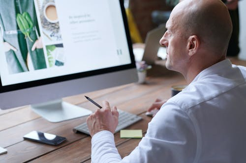 Photo Of Man Using Computer