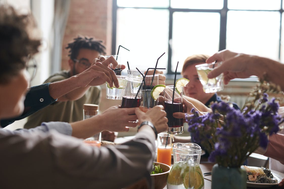 Group of Person Drinking Indoors