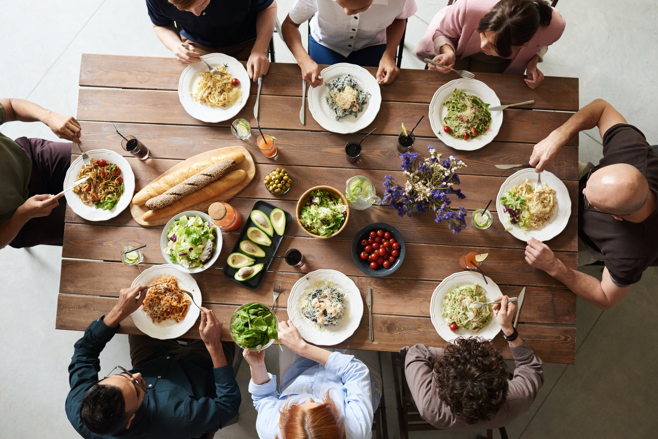 top view of eight people sharing a gluten free meal