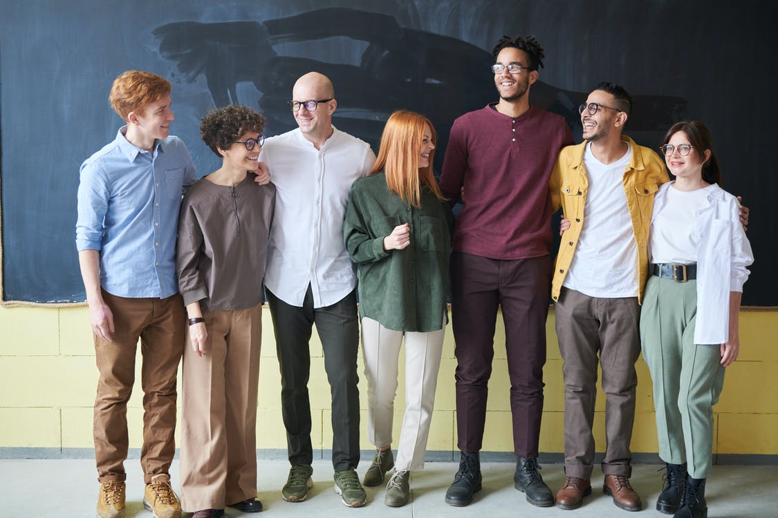 Group of People Standing Beside Chalk Board
