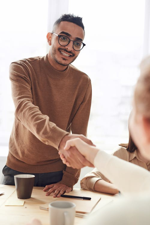 Photo Of Man Wearing Brown Sweater