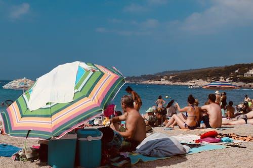 Photo Of People On Seashore During Daytime