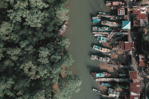 Aerial Photography of Boats Near Body of Water