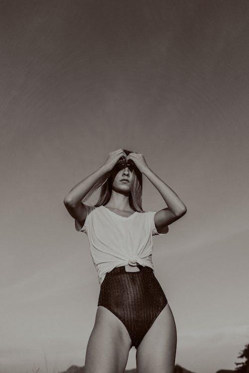 Monochrome Photo Of Woman Wearing White Top