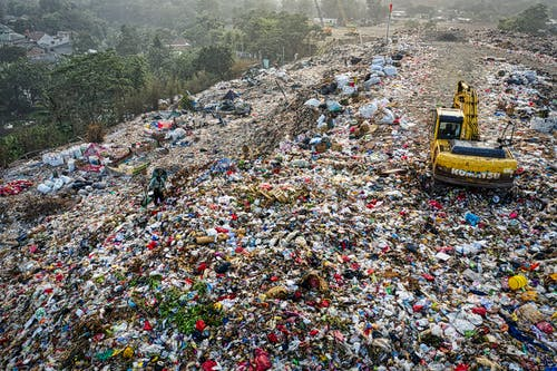 Yellow Excavator in Garbage Mountain