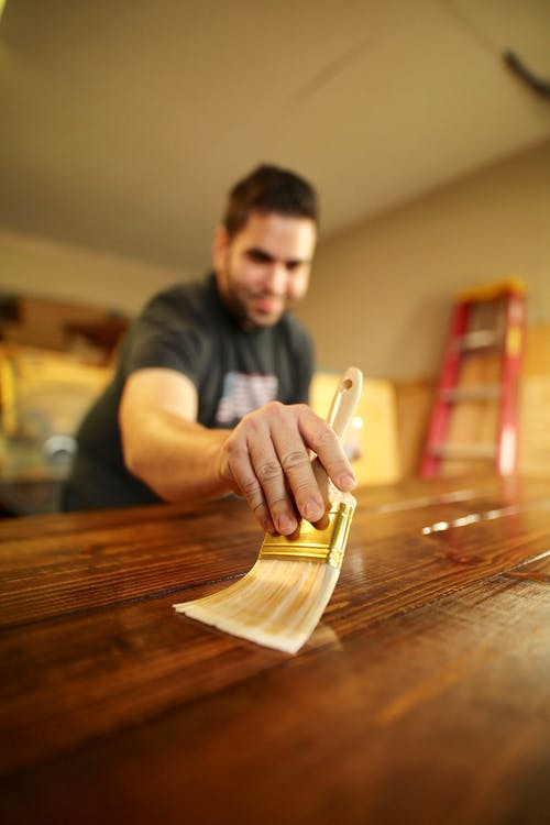 Photo of Man Applying Varnish
