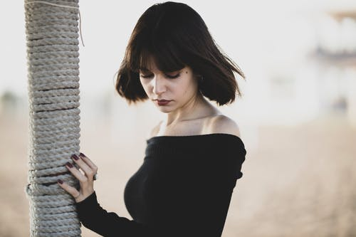 Woman Wearing Black Off-shoulder Top