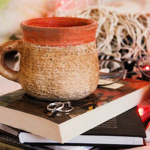 Clay Mug on Book