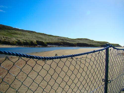Free stock photo of beach, dunes, fence, floating bridge