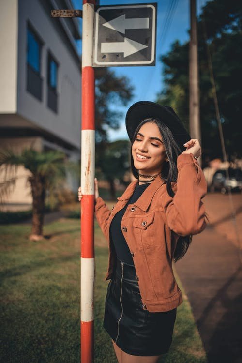 Woman Wearing Brown Denim Jacket