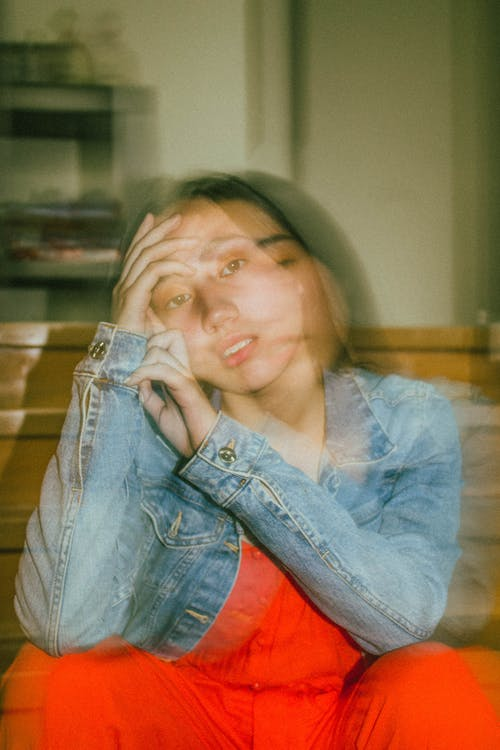 long Exposure Photo Of A Young Girl Sitting Wearing Denim Jacket