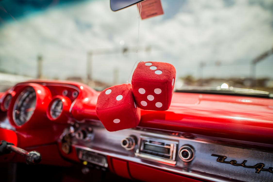 Two Red Dice Decor Hanging inside Red Car