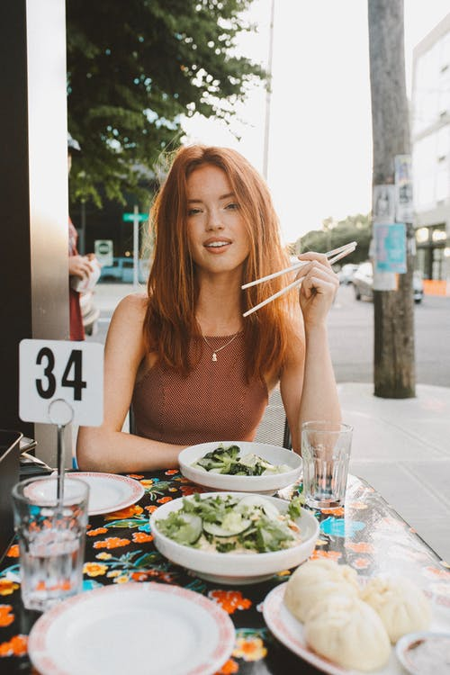 Woman Eating Outside
