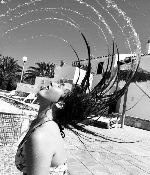 Grayscale Photography of Woman Splashing Hair