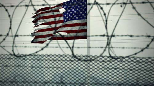 Free stock photo of American flag, barded wire, detention camp, guantanamo bay