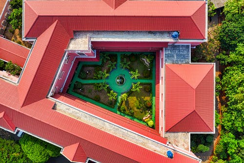 Aerial View of Red-Orange Roof Buildings and Trees
