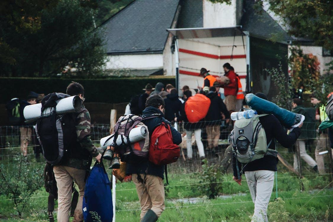 Photo Of People Bringing Backpack