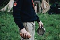Man Holding Grey Pot