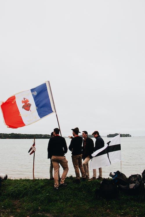 Men Holding Flag