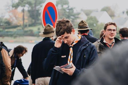 Boy Holding Brochure