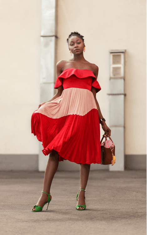 Woman Red and Pink Off Shoulder Dress Standing Near Wall