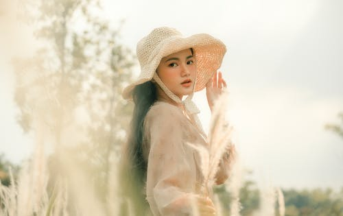 Selective Focus Photo of Woman Wearing Sun Hat