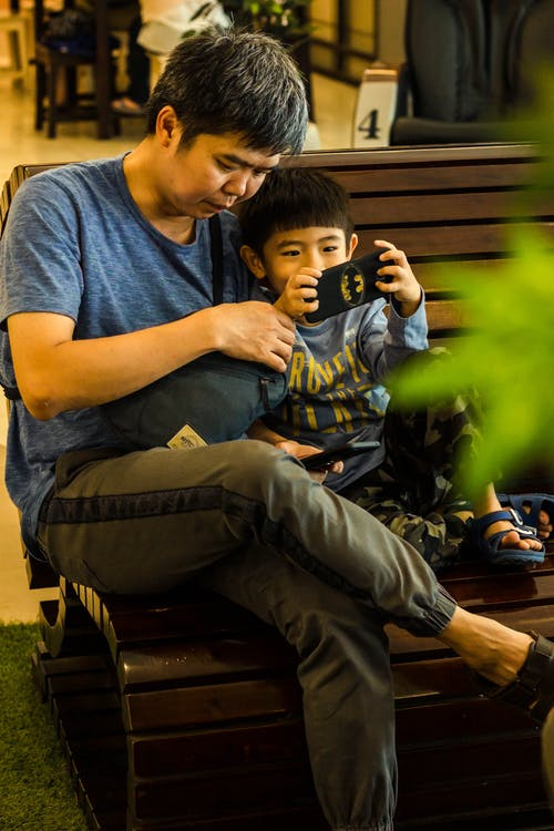 Free stock photo of family, father and son, playing, together