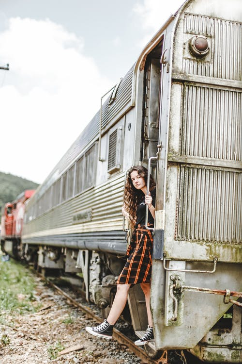 Woman Wearing Dress Standing On The Doorway Of An Old Train
