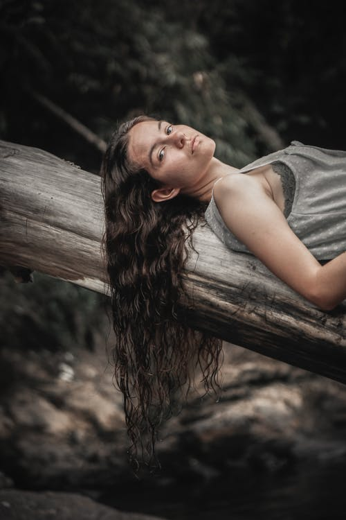 Woman Lying on Log