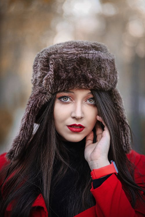 Shallow Focus Photo of Woman Wearing Winter Fur Hat