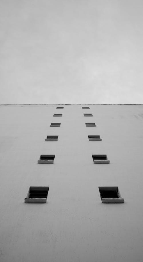 White Concrete Building Under White Sky