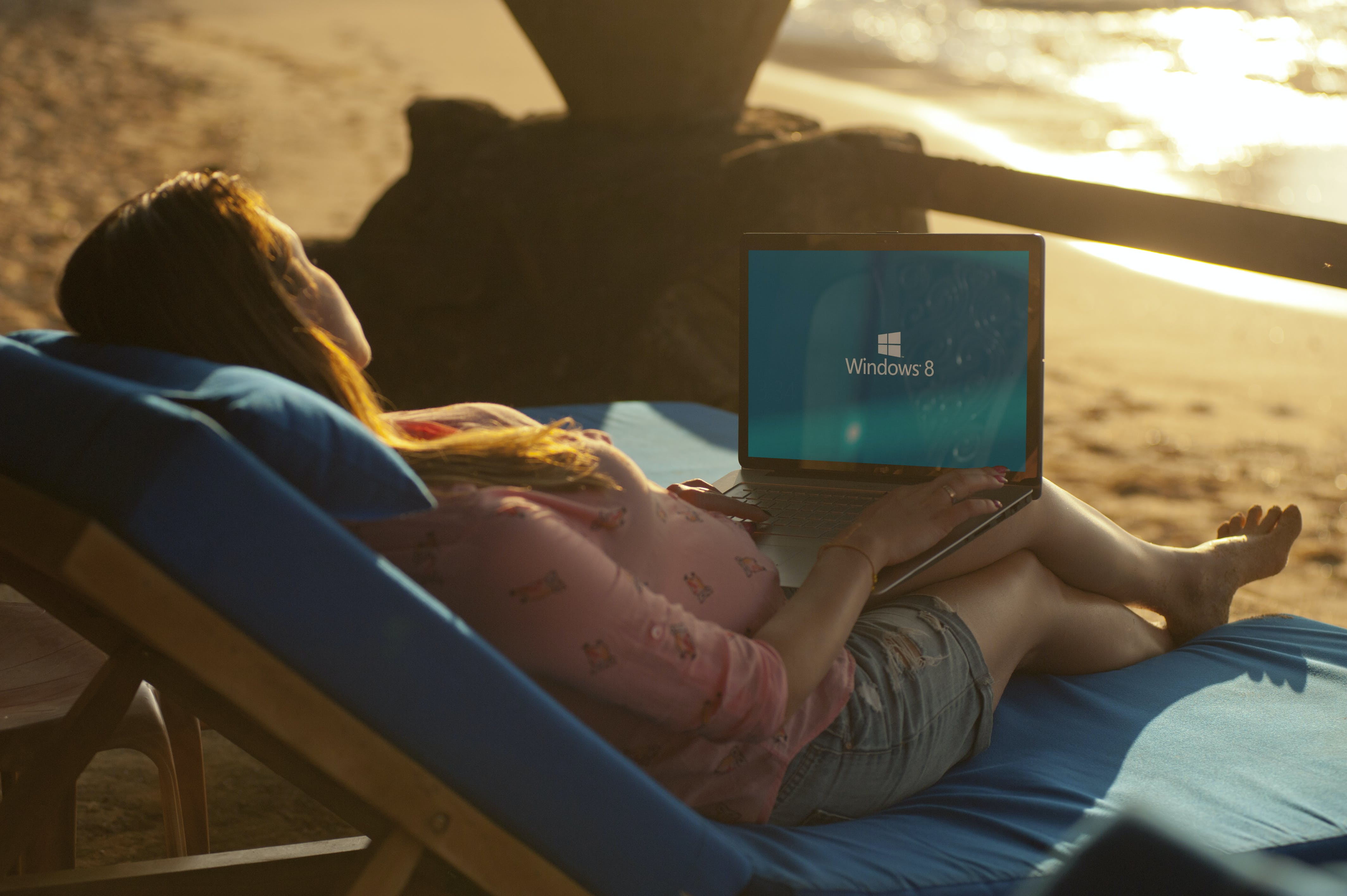 Woman Using Gray Laptop on Beach