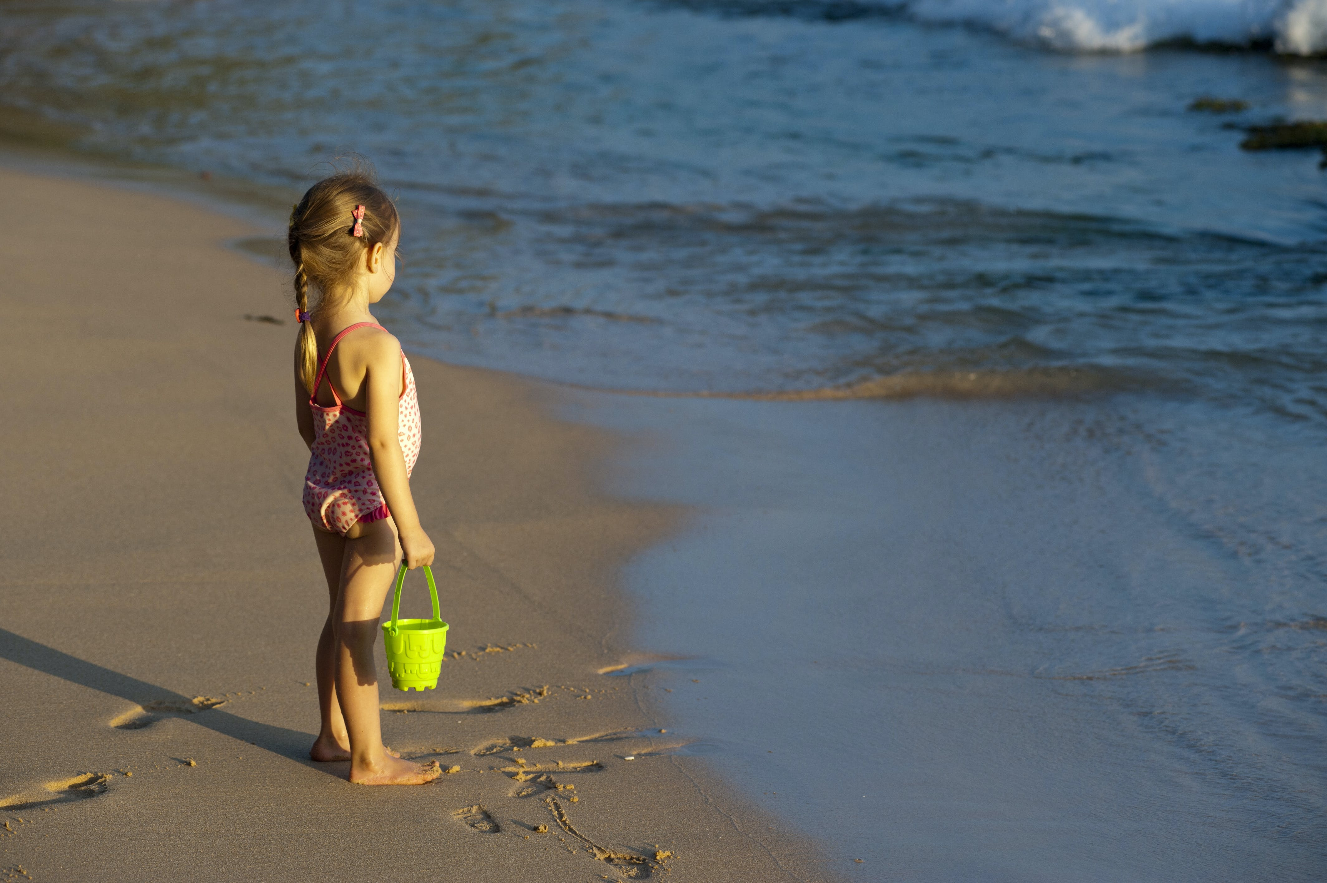 Girl Holding Bucket on Seashore