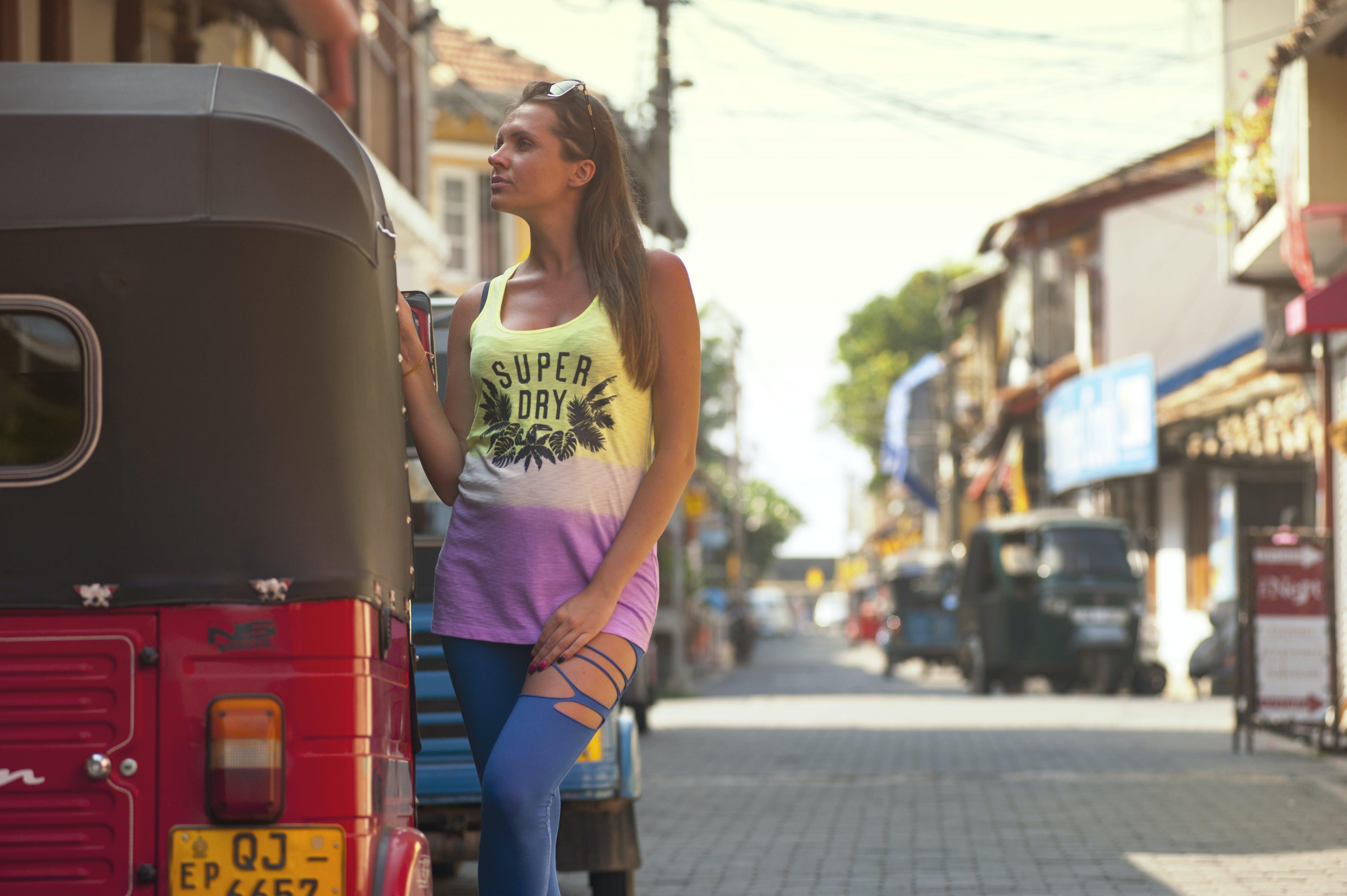 Woman Standing Beside Auto Rickshaw