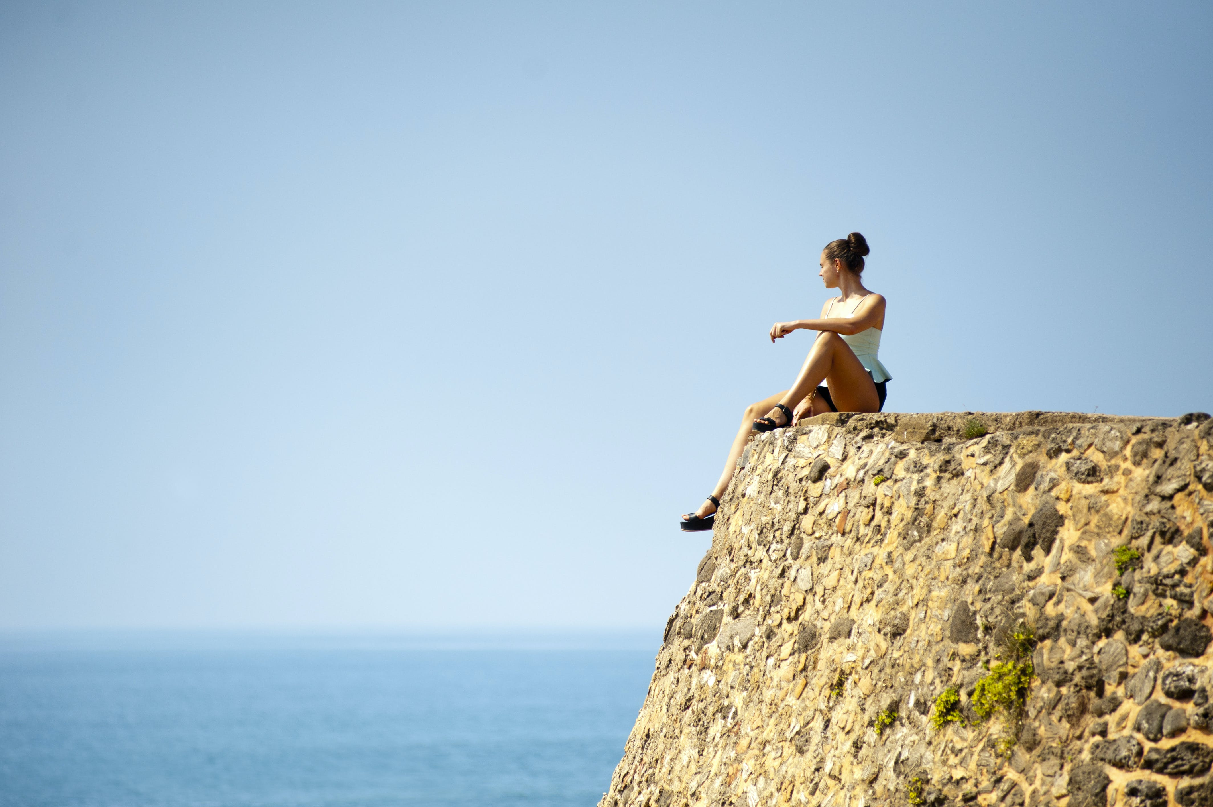 Woman Sitting on Edge