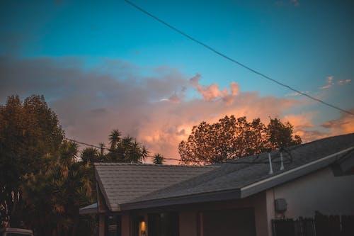 Foto d'estoc gratuïta de barri, capvespre, cel, cels