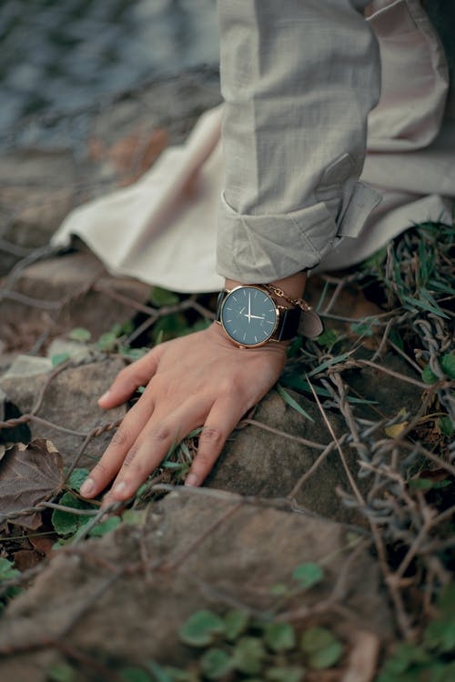 Person Wearing Round Gold-colored Analog Watch
