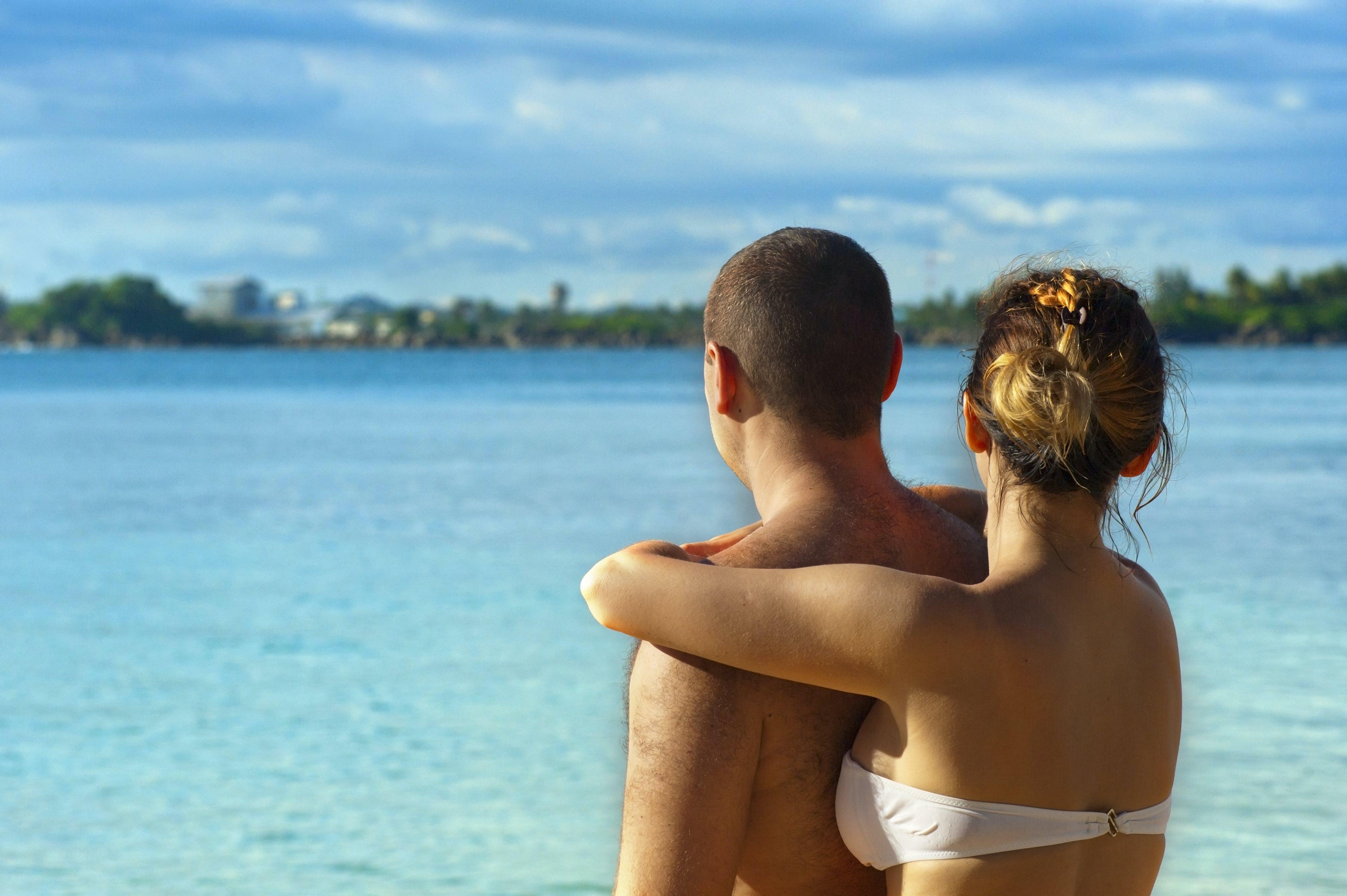 Woman Embracing Man Near Water