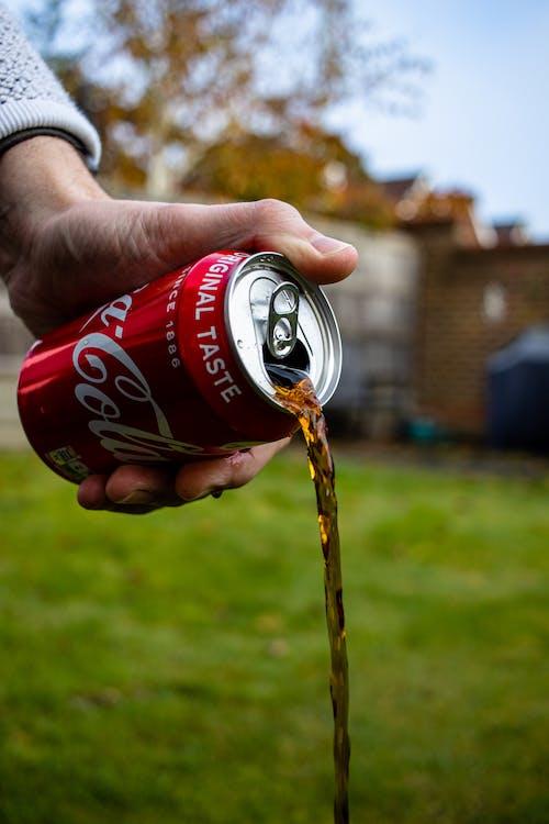 Person Pouring Coca Cola Can