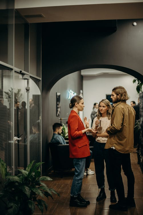 People Talking in Well-lit Room