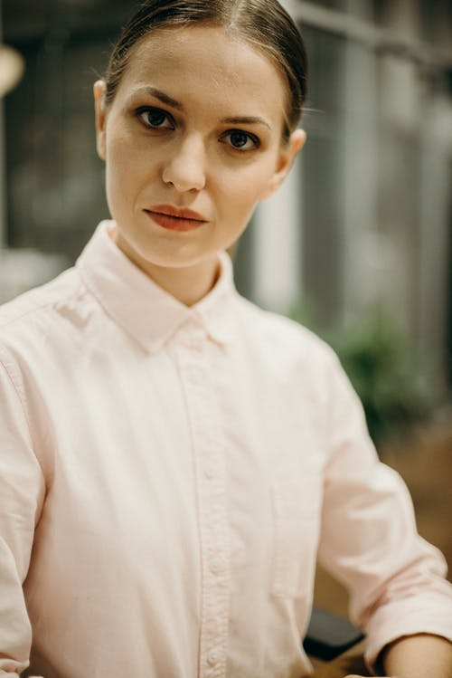 Woman in White Collared Shirt