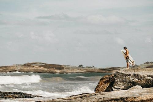 Fotos de stock gratuitas de agua, dice adiós, hacer surf, luz de día