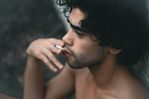 Topless Man Smoking