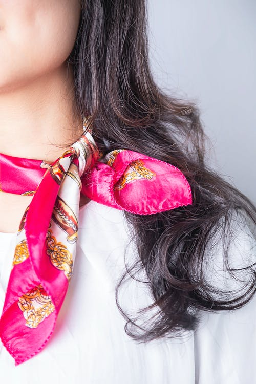Photo of Woman Wearing Pink Silk Bandana