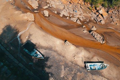 Photos gratuites de bateaux, boue, cailloux, dehors