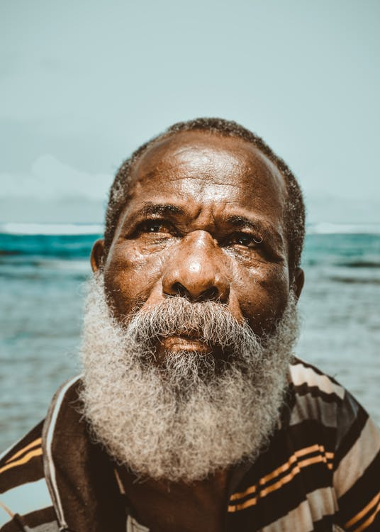 Portrait Photo of Man Looking Up